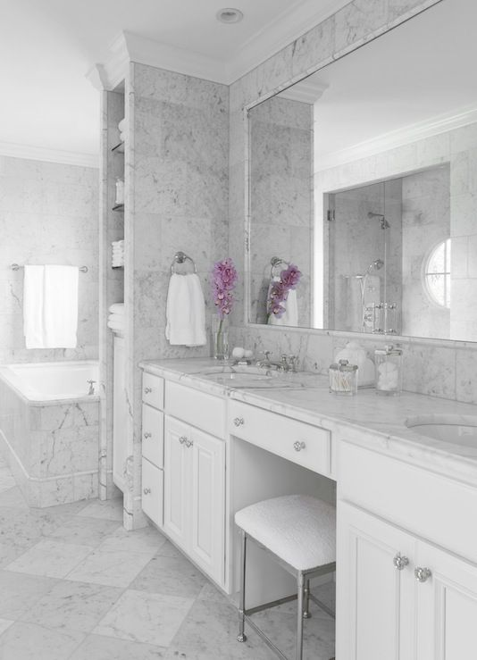 Beautiful marble master bathroom with white bathroom cabinets, Walker  Zanger's Statuarietto marble counter top, double sinks, Venatino marble  tiles