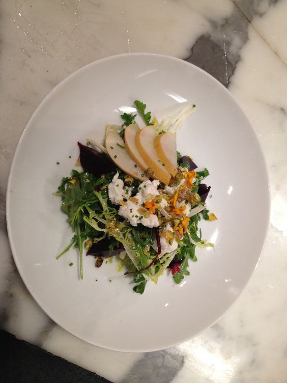 Wild Arugula-Young Frisee' & Asian Pear Salad Sonoma Goat Cheese/ Baby Red Beets / Pistachio Brittle/ Pear Vinagrette