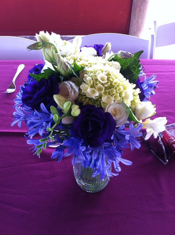 Blue agapanthus with purple lizanthus mixed with white roses and green hydrangea