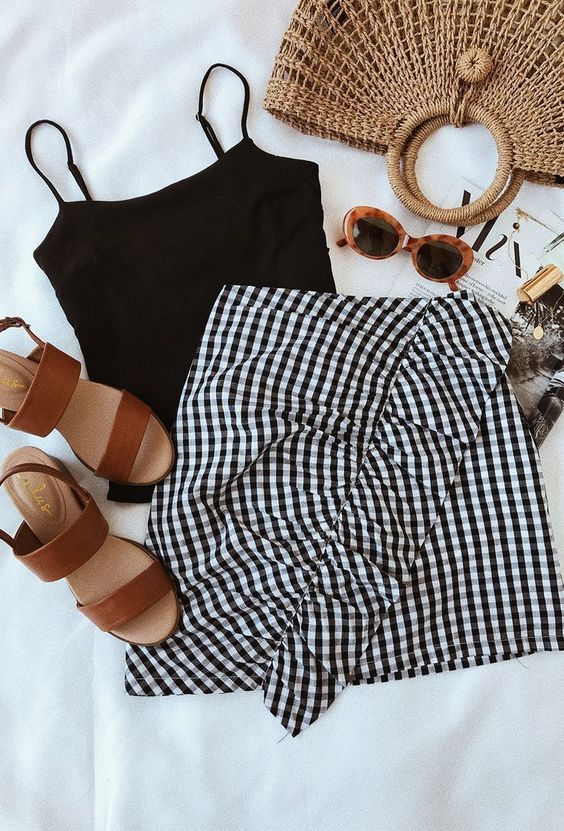 Black top with gingham skirt and sandals