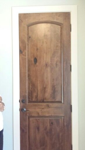 Doors... stained knotty pine. Note the Linen-color trim and soft sage wall color.   With all the lighter colors we are targeting, stained doors add depth and character