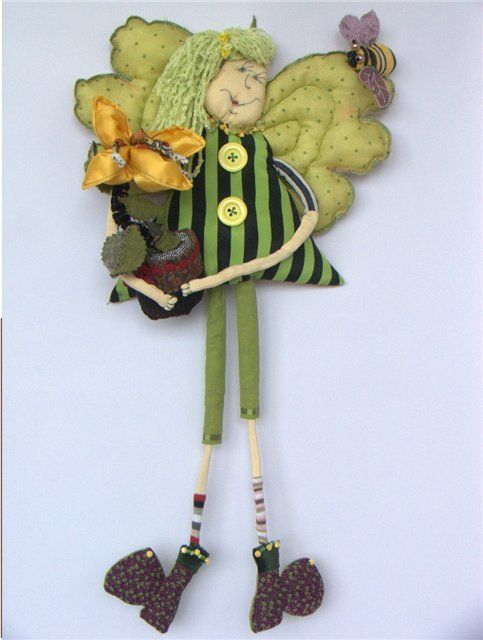 crazy doll with wings and a plant