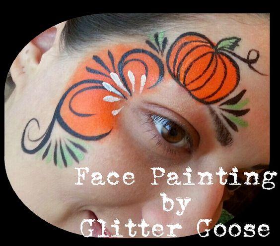 Pumpkin eye design. Face painting by Glitter Goose! halloween autumn thanksgiving paint ideas cute.