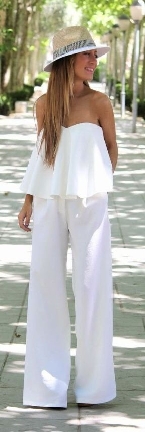 A strapless bandeau white jumpsuit with wide-leg pants looks pretty stylish updated with fedora hat.: