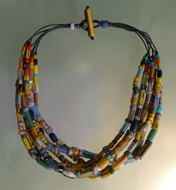 "Mix of Venetian collectible beads: These beads are around 100 years old originally made in Venice for trade to the Africans, A mix of what is commonly called ""Chevrons' and ""Christmas beads"", strung on waxed leather 