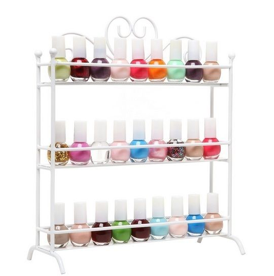 3 Tier Nail Polish Metal Rack Table Top Organizer Display Storage Small Bottles White Store your bottles of nail polish and makeup in style with this amazing 3 Tier Nail Polish Display rack! The lovely scrollwork design and classic painted finish on this sturdy metal storage rack helps bring both eye-catching style and sensible storage to your home or salon, and the 3 tiers (each with a metal railing) allow you to store your nail polish and makeup while also keeping them beautifully…
