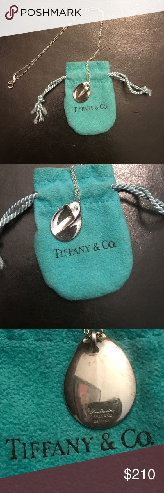"""Tiffany & Co. Necklace Tiffany & Co. Elsa Peretti """"Madonna"""" Pendant Necklace. Pendant is sterling silver, and approx. 20 mm wide. Pendant has """"Elsa Peretti, Tiffany & Co. and 925 Spain"""" engraved on the back. On a 16"""" chain that also has """"Peretti"""" """"Spain"""" """"925"""" and """"Tiffany & Co."""" Necklace has some minor tarnishing and scratches as pictured but is in overall good condition. Comes with Tiffany & Co. pouch. Tiffany & Co. Jewelry Necklaces"""