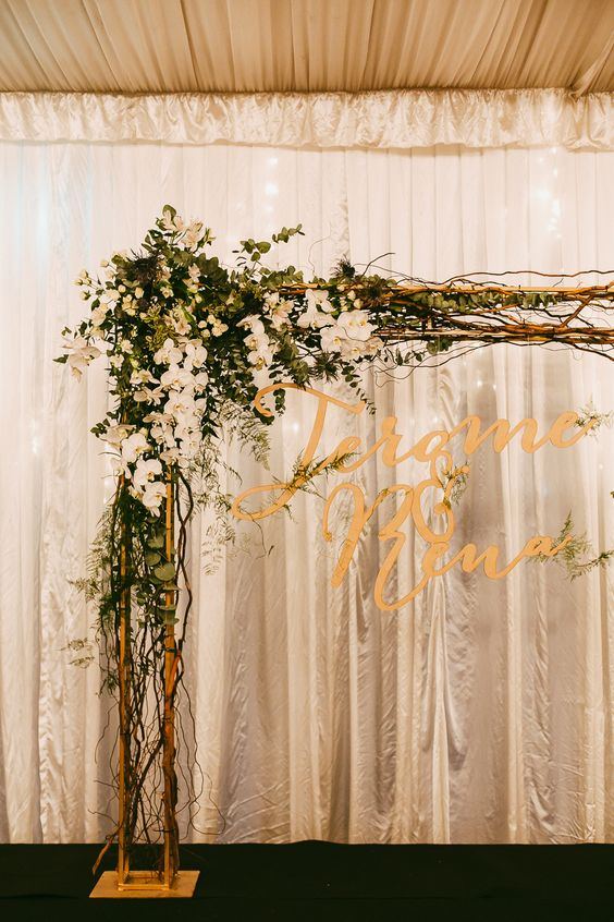 Wedding Arch With Florals And Laser Cut Sign With The Couples Names Photo By Samuel Goh