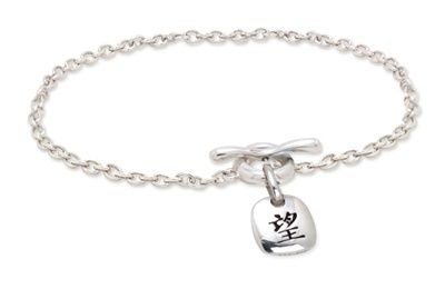 This toggle bracelet features the Chinese character for hope on a silver charm. The square charm slides along the ring of a free-form toggle clasp, attached to a silver cable chain.The silver hope bracelet is an original design by Jennifer Scarbrough, creator of Zia Jewelry. Her Chinese character jewelry is inspired by Chinese sentiments like Strength, Love, Hope, Peace, and Happiness. View matching items in this collection including the