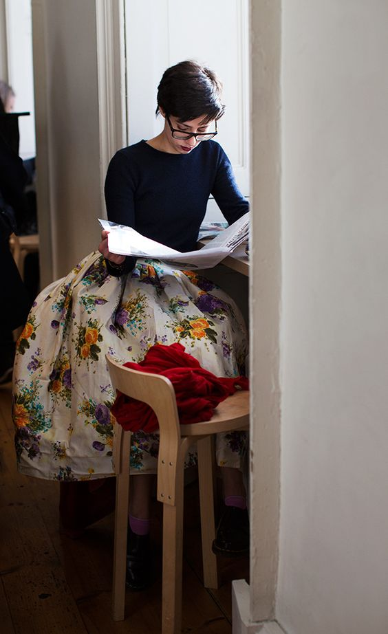 All my faves here: big floral skirt, docs, great hair and a big scarf? Well some kind of cosy layer on the chair. Oh, and i mustn't forget reading in a cafe!
