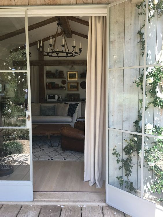 Guest house at Patina Farm (a modern farmhouse by Giannetti Home in Ojai, California). Steel French doors, wide French oak flooring, and plaster walls. #giannetti #patinafarm #guesthouse