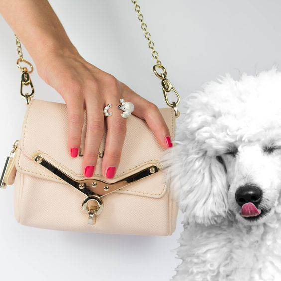 """Pictured: #Poodle Sterling Silver #HugRing with #ColoredEnamel  Many more breeds in-stock! Please call 770.434.4367 to learn more about all that is available.  """"The craftsmanship, the colors, the innovative design and combinations of precious metals and stones make Dog Fever jewelry products unique, suitable for those who want to stand out: rings, bracelets, earrings and pendants form a collection, leaving the wearer feeling unique.""""   #CDE #DogLovers #nofilter #perfectgift #dogstagram…"""