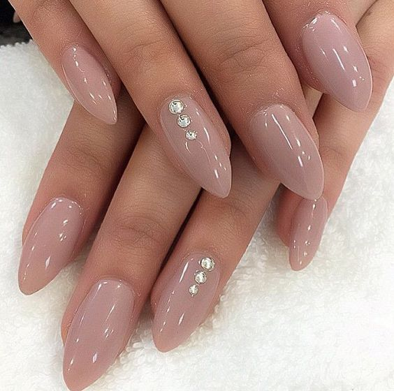 Nude nails with just a little bling so it won't compete with your ring