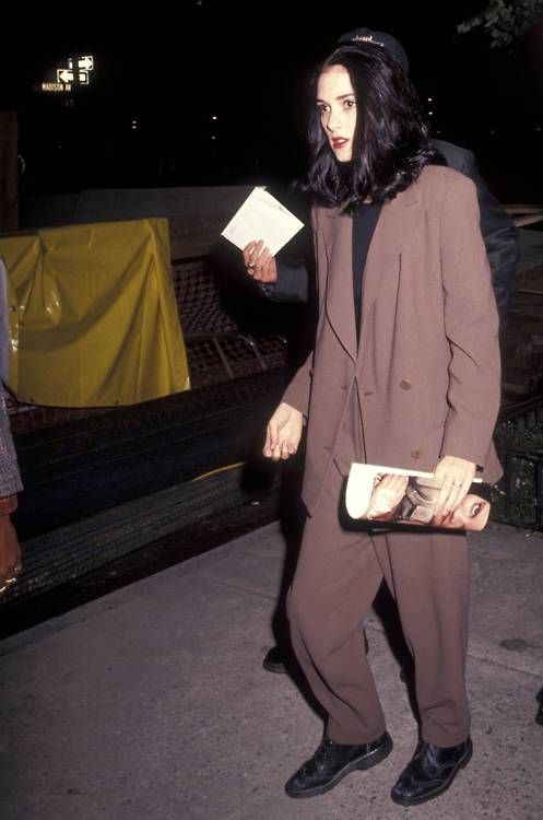 winona looks really great in men's suit                              …