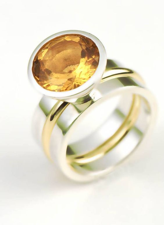 This is a large citrine ring set in silver with a removable yellow