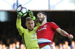 Everton's Maarten Stekelenburg puts the ball into his own net after a challenge by Middlesbrough's Alvaro Negredo.