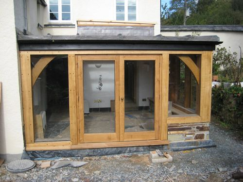 Traditional oak timber frame manufacture devon for Wooden garden rooms extensions