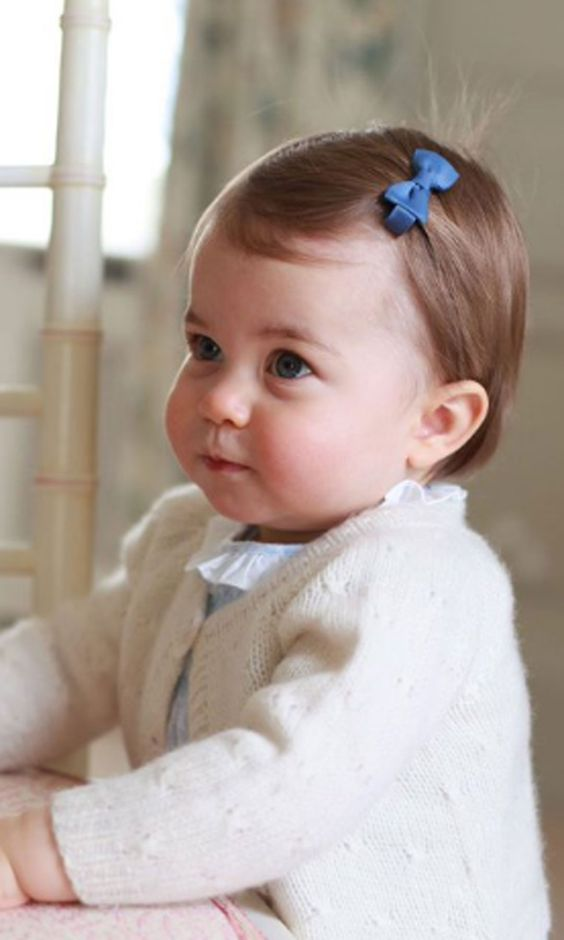 It's Princess Charlotte's 1st birthday! These photos show just how quickly she's growing up.: