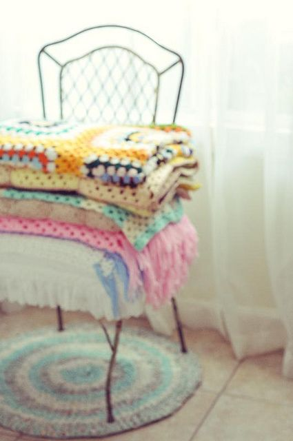 I love the angle in which this photo was taken and the gorgeous stack of handmade crochet throws.