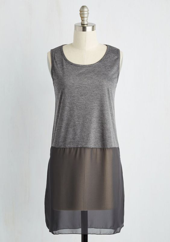Float on the fashionable feeling you get from wearing this grey tank top! Finessed with a heather knit upper and a sheer woven hemline with dramatic side vents, this ethereal tunic takes casual elegance to the next level.: