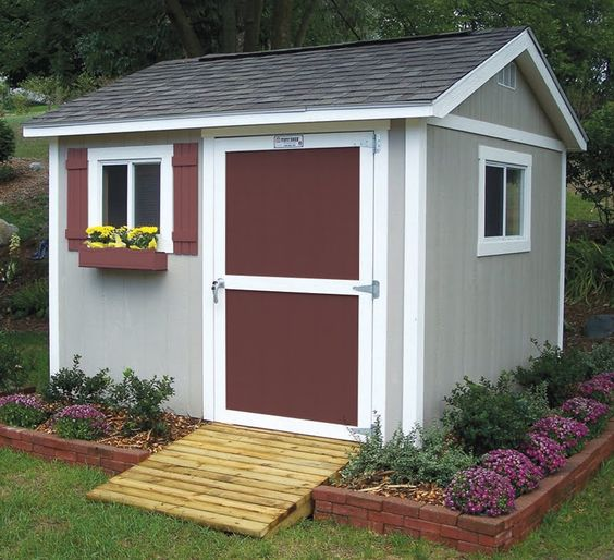 brick around shed with mulch and flowers