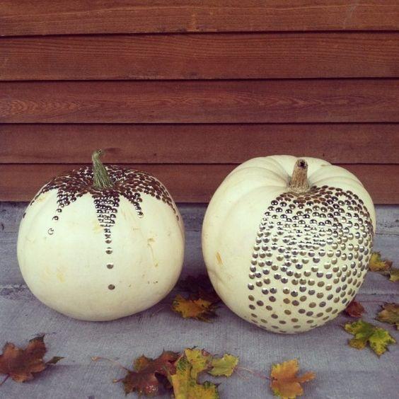 An interesting DIY: pumpkins decorated with tacks.