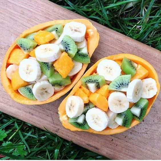 Afternoon snack! Loving this idea of papaya boats with mango,banana and kiwi…