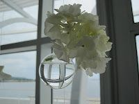 {Beautiful Wedding Backdrop} The collection of glass vases were filled with water and filled with Hydrangea, calla lilies, Ranunculous and orchids.