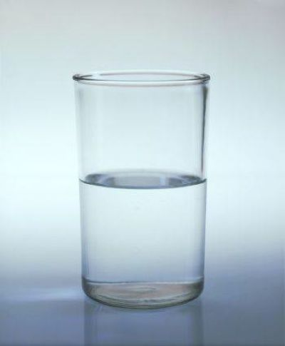 """i am not sure if this would be the exact image we use, but it could be the glass half full and the under it, it says """"You Decide"""" The colors could be shades of blue and maybe yellow"""