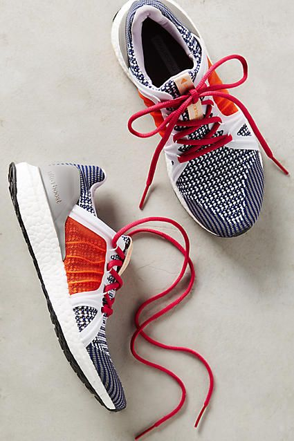 red and blue Adidas running shoes