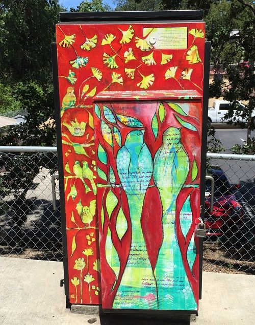 Ginko leaves and birds adorn this utility box in Auburn.