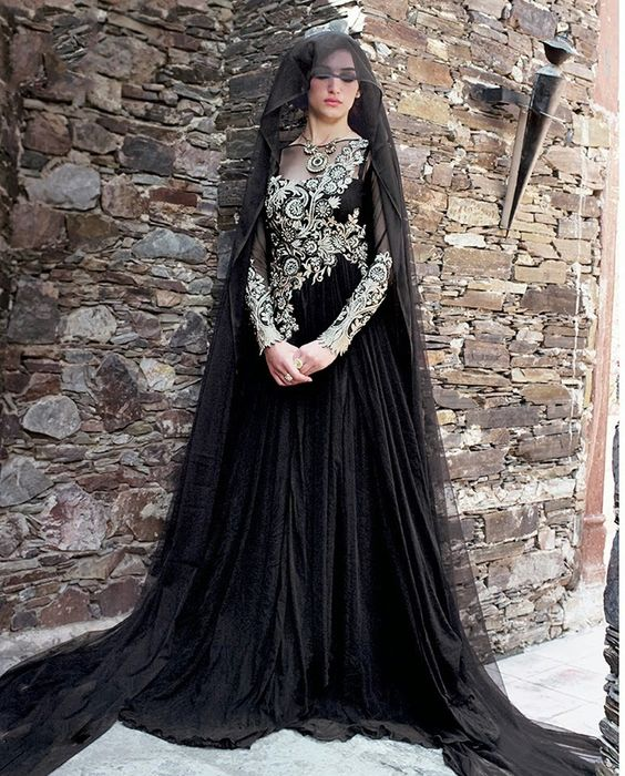 Black gown with floral embroidery on back   1. Black net  gown2. Comes with dupatta3. Can be stitched upto bust size 42 inches