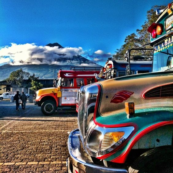 Buses & Agua volcano view from Antigua market, Guatemala: