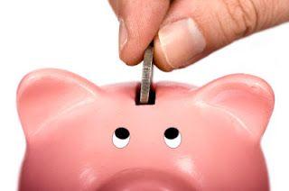 piggy bank watches hand putting in money