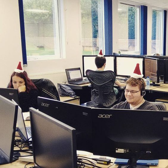 Our Software Developers are Getting in the Christmas Spirit!  #xmas #santahat #work #software #developers #office #technology