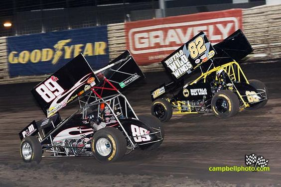 Justin Henderson races David Gravel for 2012 Friday Knoxville Nationals A-Main - Mike Campbell photo