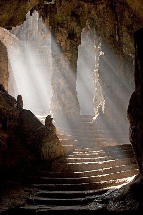 Sun shining into the entrance to the Khao Luang Cave temple, Phetchaburi, Thailand.   © Craig Ferguson
