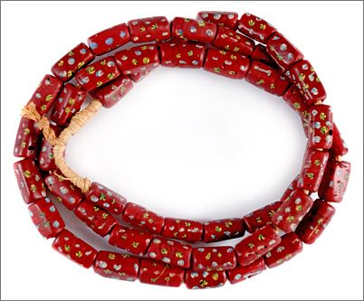 Delicate brick red Ventian Fancy beads with blue, yellow and white trail decoration. These beads were used in the African trade from the late eighteen hundreds through the mid nineteen hundreds. $169. TimeStreams.com