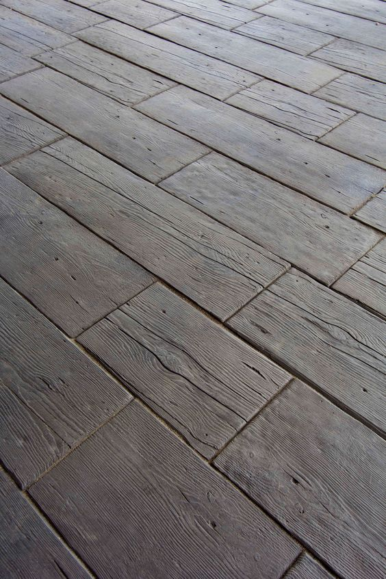 """Rustic wood? Nope - 2"""" thick concrete pavers.  'Barn Plank Landscape Tile' by Silver Creek Stoneworks, Rochester, MN. Ideal for outdoor paths, decks, etc. (Riser steps also available.) http://www.silvercreeksw.com/barn-plank.htm#.VNv0_0fF_RY"""