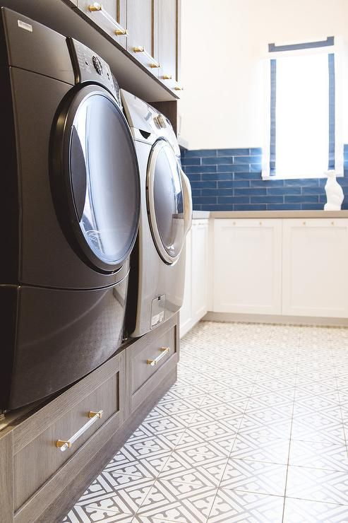 A Black Front Loading Washer And Dryer
