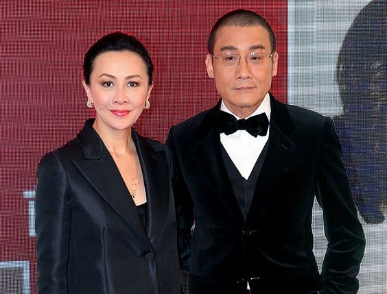 """Hong Kong actors Carina Lau and Tony Leung Ka-fai paired up during the premiere of their new romance movie """"Beijing Love Story"""" in Hong Kong, China, March 10, 2014."""