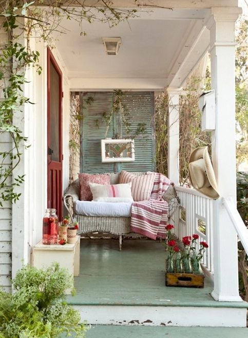 Country chic porch - Everything's just right except for the light fixture. A sweet little chandelier would've been perfect!