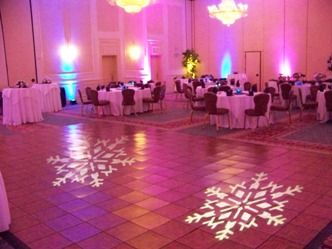 In March of 2013, I entertained at a Sweet 16 Party at the Ambassador Center in Erie. As you can see, per request of the client, I used combination of purple and blue uplighting. To add some 'bling', also by request, I projected two snowflake monograms on the dance floor.