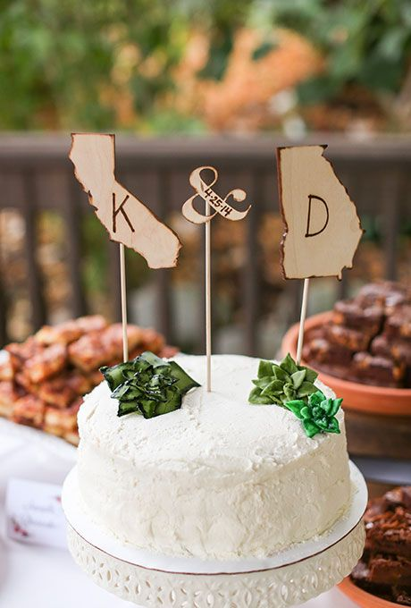 State-shaped wedding cake toppers with the bride and groom's initials | Brides.com: