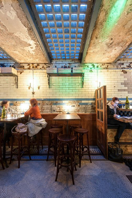 Existing Decayed Brick Wall With Industrial Skylights WC Wine Charcuterie