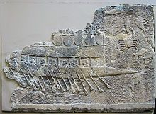 Assyrian warship (probably built by Phoenicians) with two rows of oars, relief from Nineveh, c. 700 BC