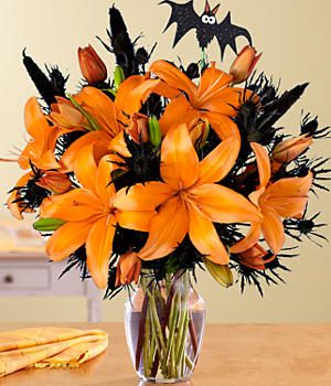Add Some Spooky Decor With Halloween Flowers - Style Estate -(with something besides that bat for the wedding)