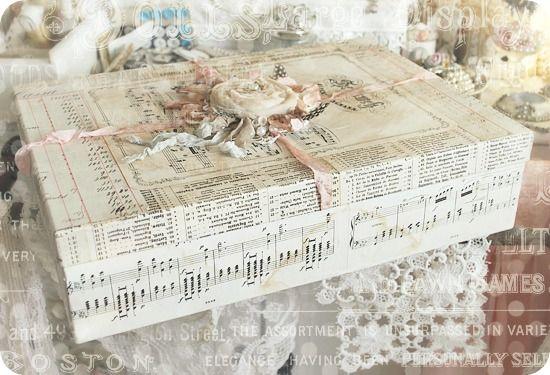 Altered box, embellished with vintage sheet music, ephemera, ribbons, fabric rosette, and feathers