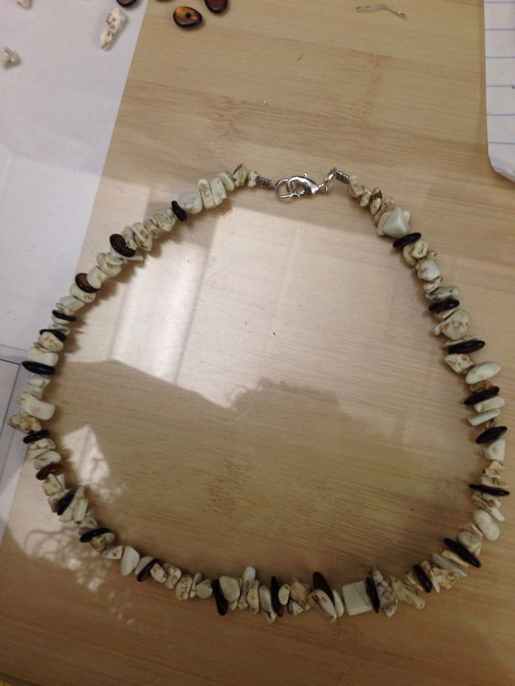 """Beach boy homemade necklace!   Bought a long shell necklace at my favorites thrift store!!  Made a shell necklace for my man, and this is a pic of the matching one I made for our son. Took the shell necklace apart, and used it along side with some Amber shells to create this simple """"surfer"""" """"beach boy"""" look! #stockingstuffers!!"""