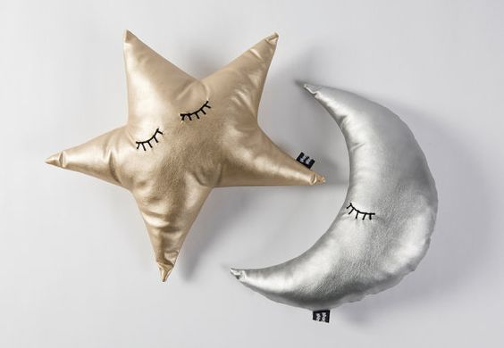Introducing the Sleepy Moon cushion! This moon pillow makes for a great nursery feature, and because it is a soft metallic silver, will fit in
